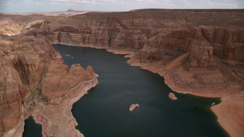Flying over Lake Powell through Navajo Canyon, Arizona  Aerial Stock Footage | AX131_231