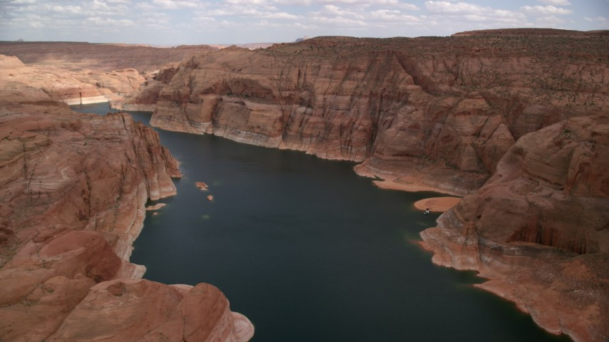 Flying over Lake Powell through Navajo Canyon, Arizona  Aerial Stock Footage | AX131_232