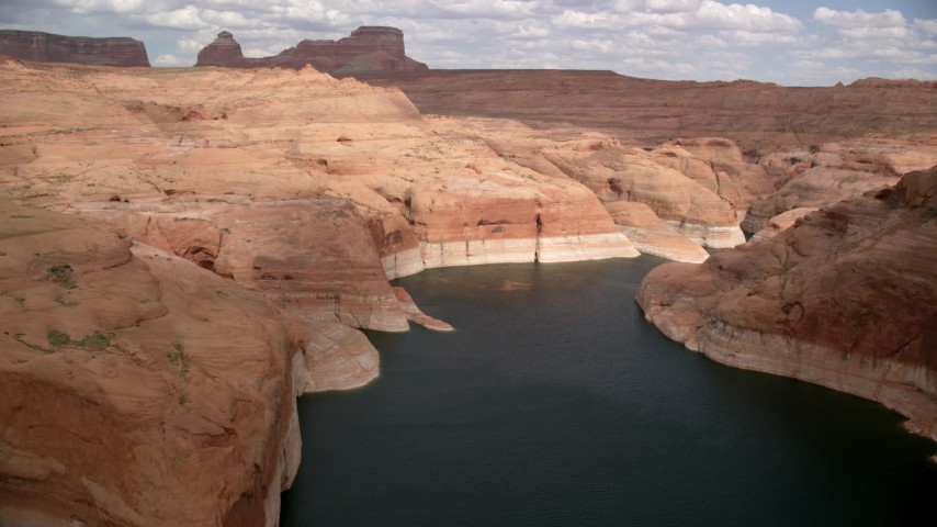 Flying over Lake Powell through Navajo Canyon, Arizona  Aerial Stock Footage | AX131_235