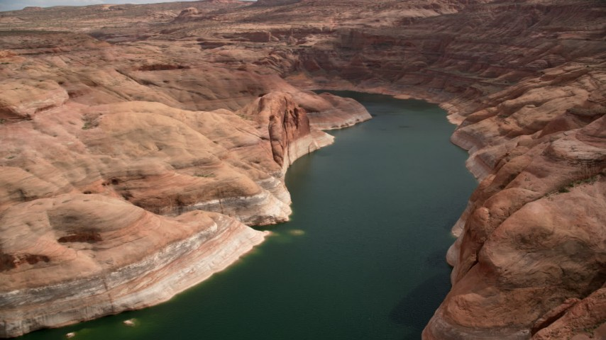 6K stock footage aerial video of following Lake Powell around a bend in Navajo Canyon, Arizona Aerial Stock Footage | AX131_237