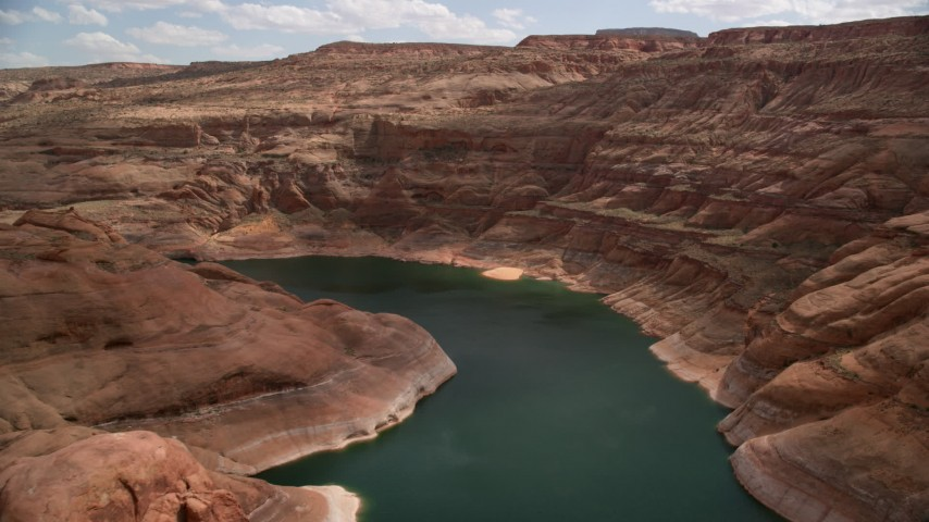 6K stock footage aerial video of flying over Lake Powell and Navajo Canyon, Arizona Aerial Stock Footage | AX131_238