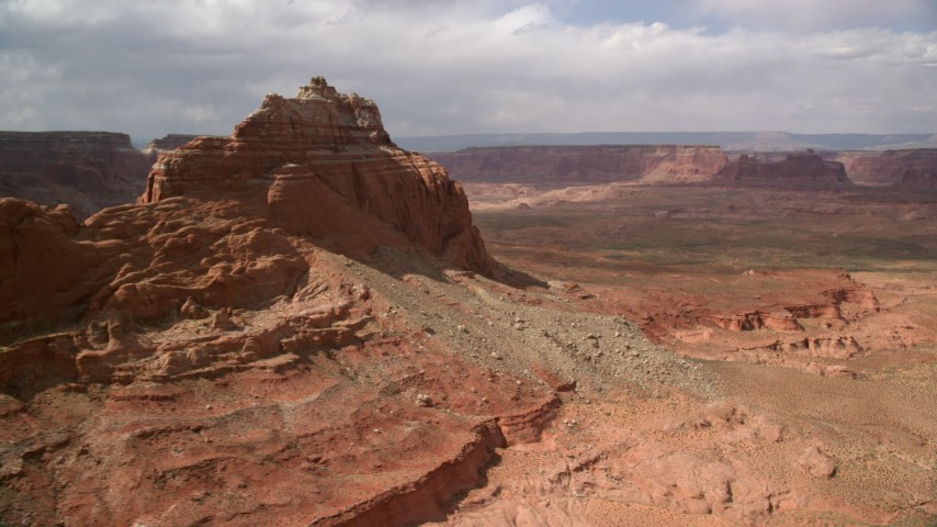 6K stock footage aerial video of flying by buttes for view of distant mesas, Navajo Nation Reservation, Arizona Aerial Stock Footage | AX131_245