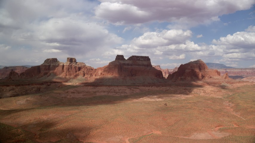 Approaching large buttes, Navajo Nation Reservation, Arizona Aerial Stock Footage | AX132_001