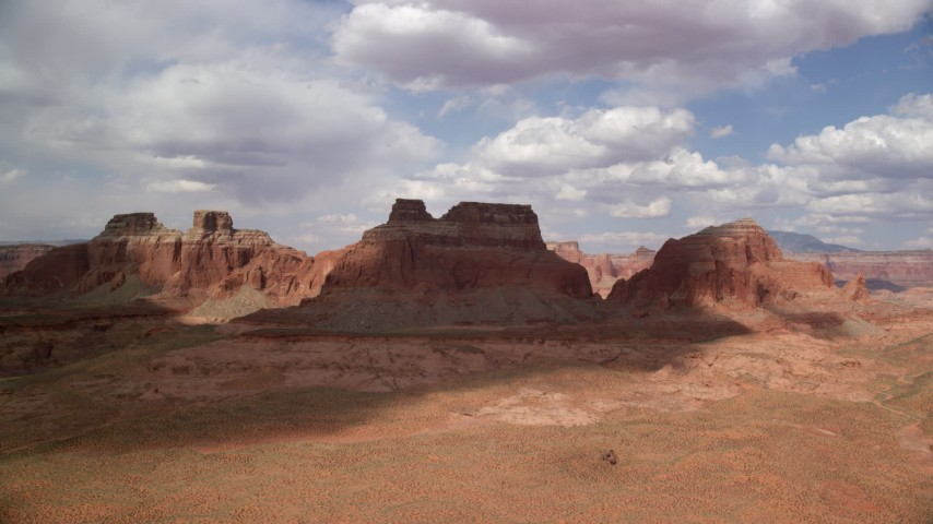 Approaching large buttes, Navajo Nation Reservation, Arizona Aerial Stock Footage | AX132_002