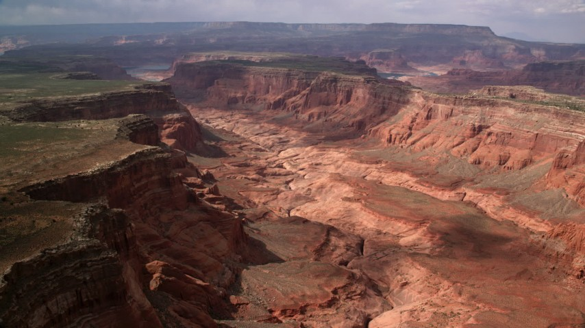 Flying by wide canyon between mesas, Navajo Nation Reservation, Utah Aerial Stock Footage | AX132_018
