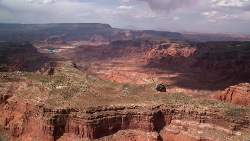 6K stock footage aerial video of flying by a mesa, approaching canyon, Navajo Nation Reservation, Utah Aerial Stock Footage | AX132_020