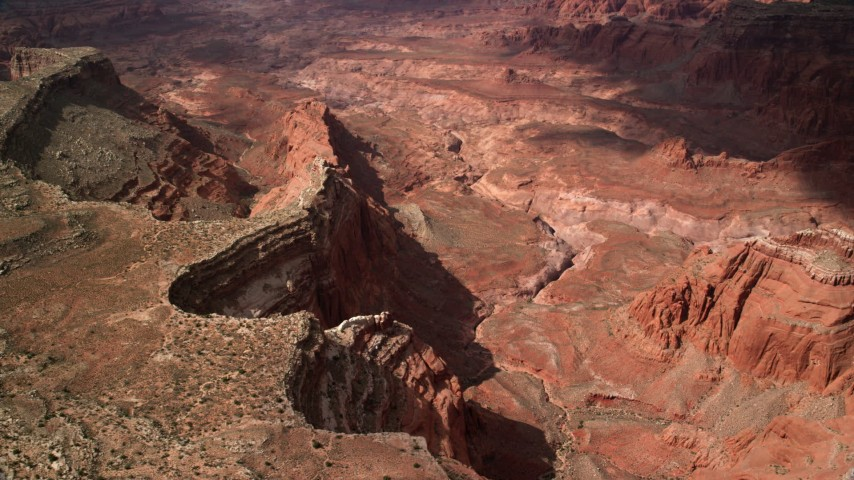 Flying by dry riverbed in deep canyon, mesas, Navajo Nation Reservation, Utah Aerial Stock Footage | AX132_022