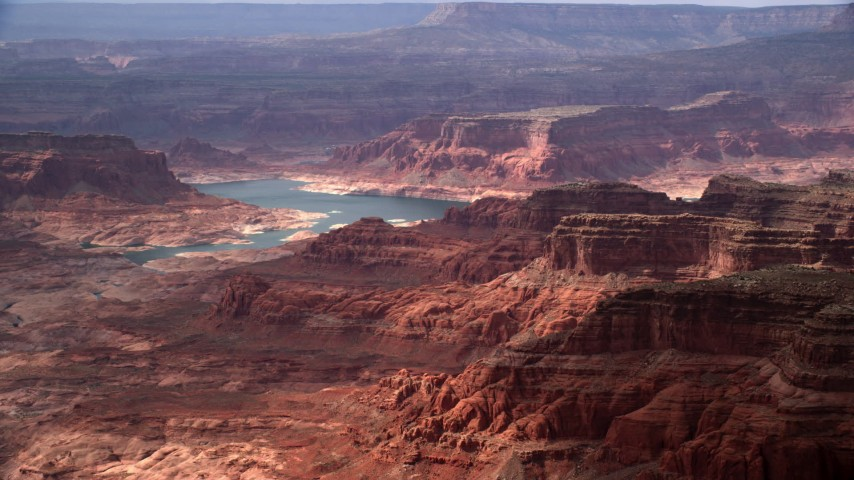 Flying by mesas, Lake Powell, Navajo Nation Reservation, Utah Aerial Stock Footage | AX132_024