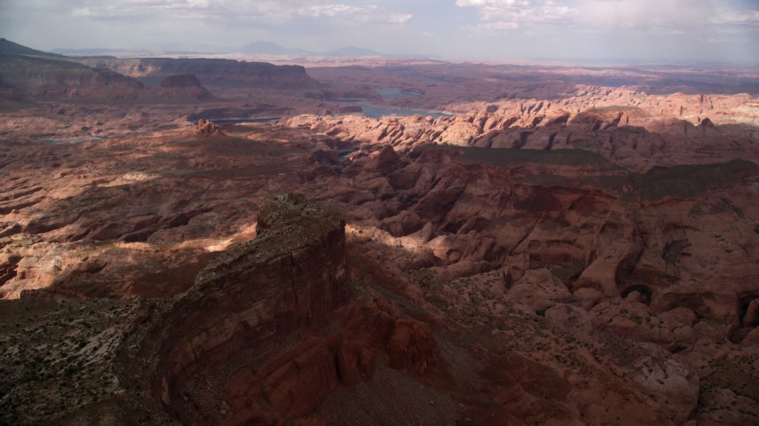 6K stock footage aerial video of a wide view of rock formations in a canyon, Navajo Nation Reservation, Utah Aerial Stock Footage | AX132_026