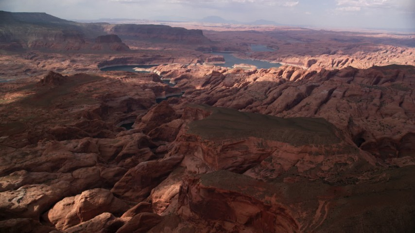 6K stock footage aerial video wide view of rock formations in canyon near Lake Powell, Navajo Nation Reservation, Utah Aerial Stock Footage | AX132_029