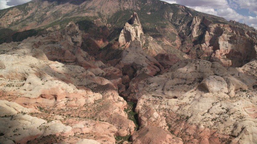 6K stock footage aerial video of tilting up the mountainside to the peak, Navajo Mountain, Utah Aerial Stock Footage | AX132_050