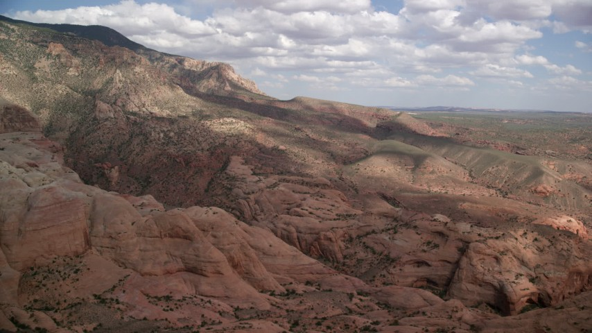 Approaching rock formations, mountain peak and slopes, Navajo Mountain, Utah Aerial Stock Footage | AX132_068