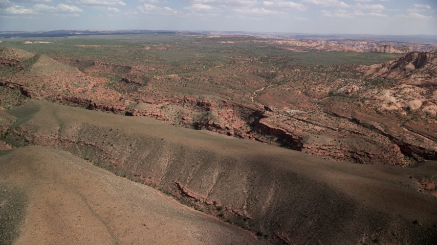 Flying by a narrow canyon, Navajo Nation Reservation, Utah Aerial Stock Footage | AX132_071