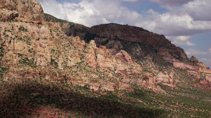 Flying by rugged desert mountain peak, Navajo Mountain, Utah Aerial Stock Footage | AX132_074