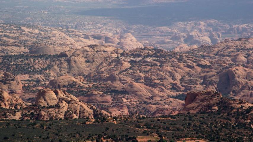 Flying by desert mountain ridges, Navajo Nation Reservation, Arizona, Utah Aerial Stock Footage | AX132_075