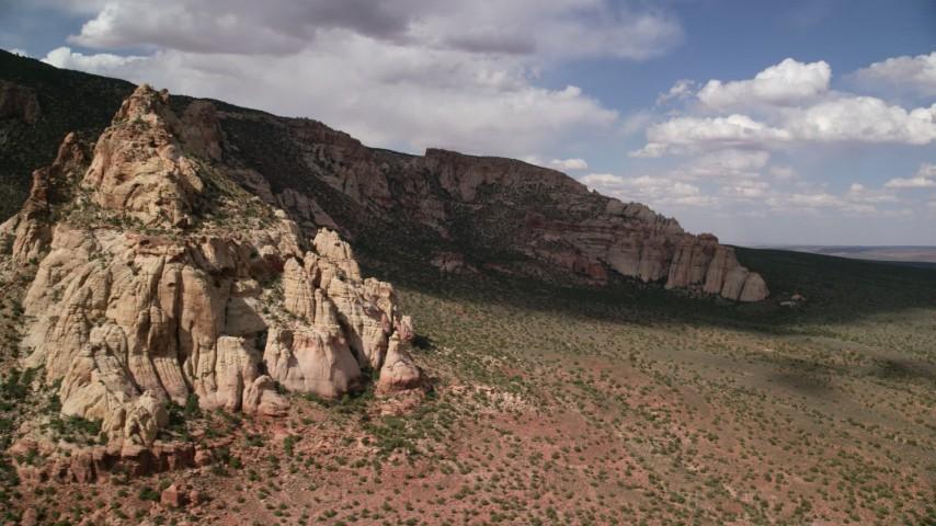 Flying by desert mountain peak, Navajo Mountain, Utah Aerial Stock Footage | AX132_077