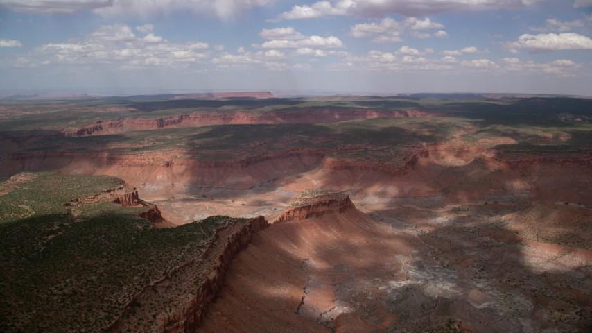 Approaching a desert canyon, mesas, Navajo Nation Reservation, Arizona, Utah Aerial Stock Footage | AX132_080