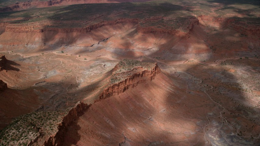 Approaching a small mesa in a canyon, Navajo Nation Reservation, Arizona, Utah Aerial Stock Footage | AX132_081
