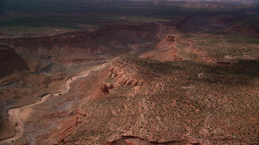 6K stock footage aerial video of passing by dry riverbed in desert canyon, Navajo Nation Reservation, Arizona, Utah Aerial Stock Footage | AX132_084