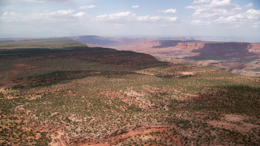 6K aerial stock footage video of a wide view of a mesa while approaching canyon, Navajo Nation Reservation, Arizona, Utah Aerial Stock Footage | AX132_085
