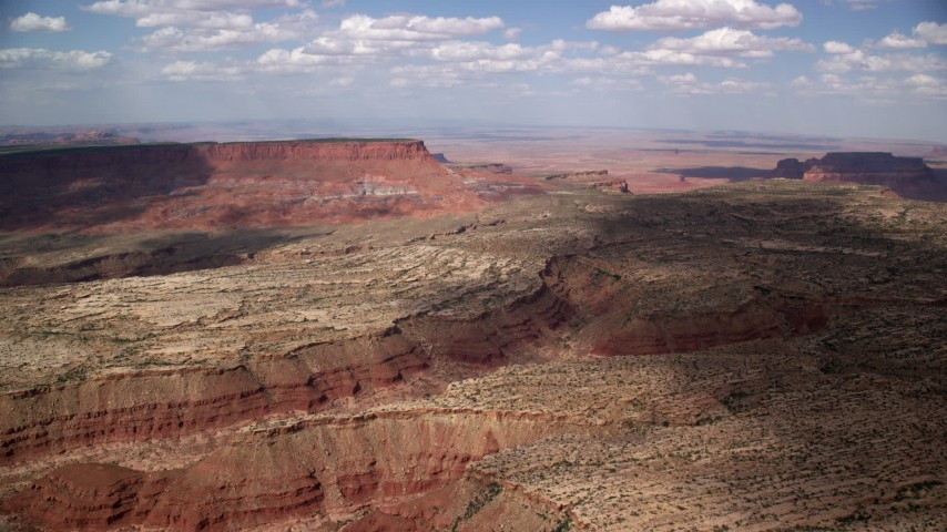 6K stock footage aerial video of an approach to a narrow desert canyon, Navajo Nation Reservation, Arizona, Utah Aerial Stock Footage | AX132_089