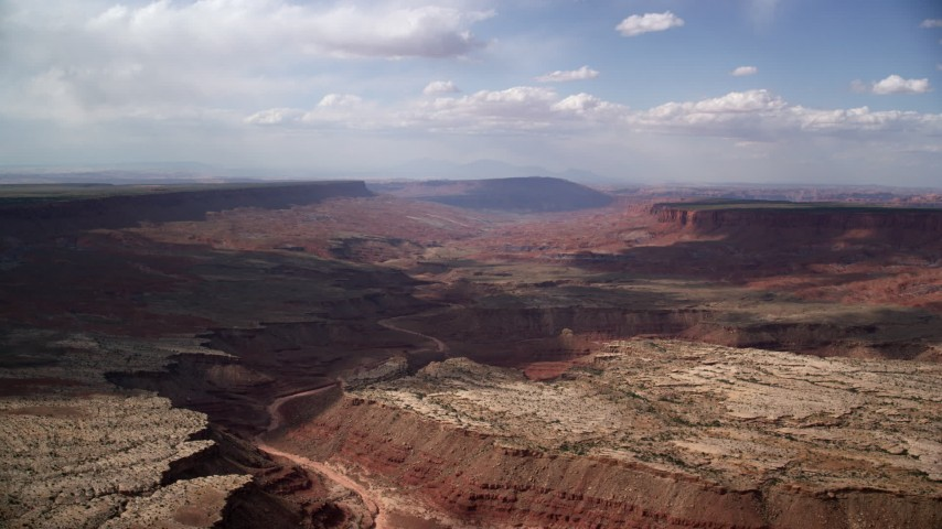 6K stock footage aerial video of flying by wide desert canyon, Navajo Nation Reservation, Arizona, Utah Aerial Stock Footage | AX132_090