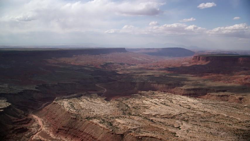 Flying by narrow canyon, wide canyon, Navajo Nation Reservation, Arizona, Utah Aerial Stock Footage | AX132_091