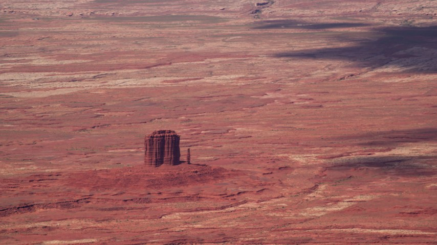 Flying by small butte, desert, Navajo Nation Reservation, Arizona, Utah Aerial Stock Footage | AX132_094