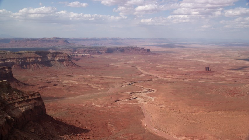 Flying by small buttes, desert valley, Navajo Nation Reservation, Arizona, Utah Aerial Stock Footage | AX132_095