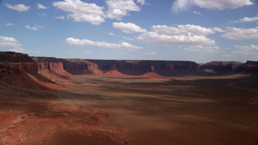 Approaching butte, wide valley, mesas, Navajo Nation Reservation, Arizona, Utah Aerial Stock Footage | AX132_097