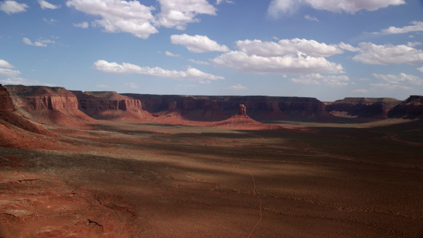 Approach tall butte, desert valley, mesas, Navajo Nation Reservation, Arizona, Utah Aerial Stock Footage | AX132_098