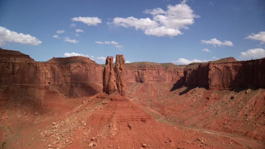Orbiting tall butte, near mesas, Navajo Nation Reservation, Arizona, Utah Aerial Stock Footage   AX132_112