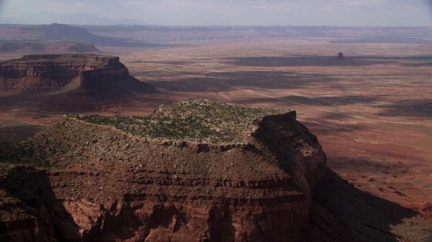 6K stock footage aerial video of flying by desert mesa, revealing second mesa, Navajo Nation Reservation, Arizona, Utah Aerial Stock Footage | AX132_122