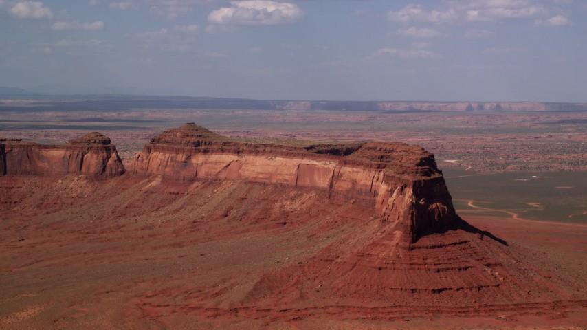6K stock footage aerial video of passing by Train Rock, desert valley, Navajo Nation Reservation, Arizona, Utah Aerial Stock Footage | AX132_125
