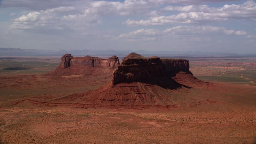 Flying by Train Rock, desert valley, Navajo Nation Reservation, Arizona, Utah Aerial Stock Footage | AX132_127