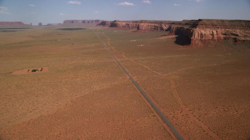 Tilt up Oljeto Road, revealing Oljeto Mesa, Navajo Nation Reservation, Arizona, Utah Aerial Stock Footage AX132_128