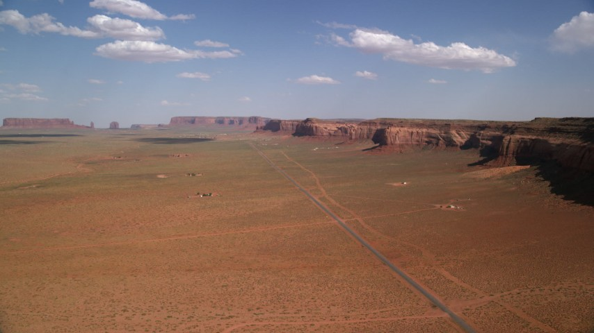 6K stock footage aerial video of flying over Oljeto Road near Oljeto Mesa, Navajo Nation Reservation, Arizona, Utah Aerial Stock Footage | AX132_129
