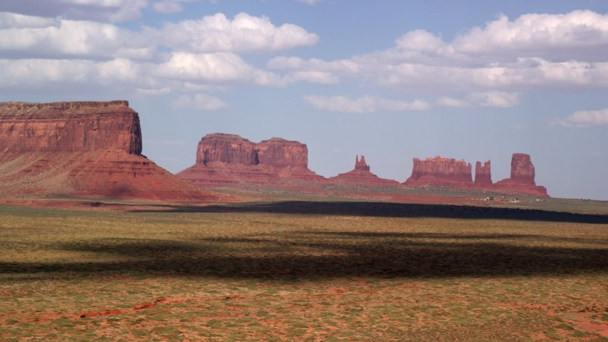 6K stock footage aerial video of a view of four desert buttes in Monument Valley, Arizona, Utah Aerial Stock Footage   AX132_134
