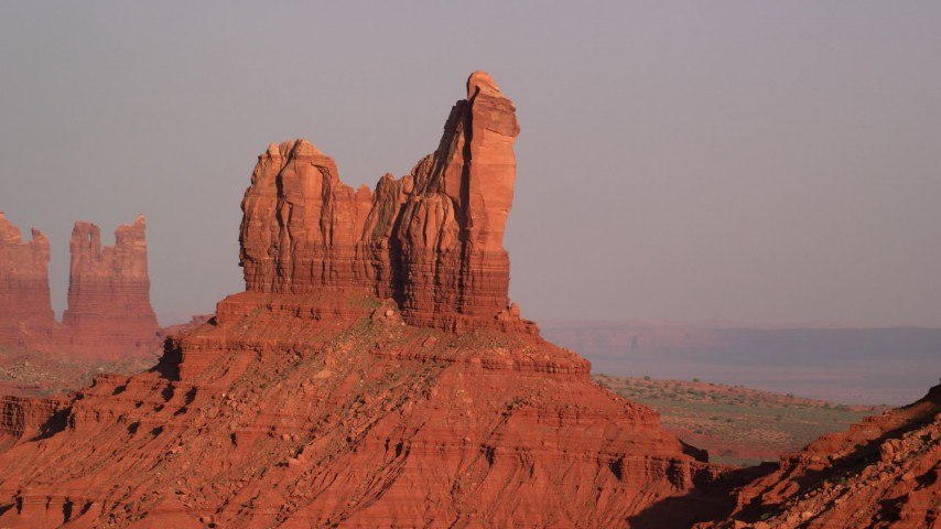 Flying by Setting Hen Butte, Monument Valley, Utah, Arizona, sunset Aerial Stock Footage AX133_007