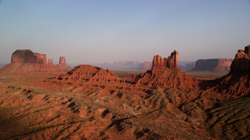 Flying by Setting Hen Butte, Monument Valley, Utah, Arizona, sunset Aerial Stock Footage | AX133_008