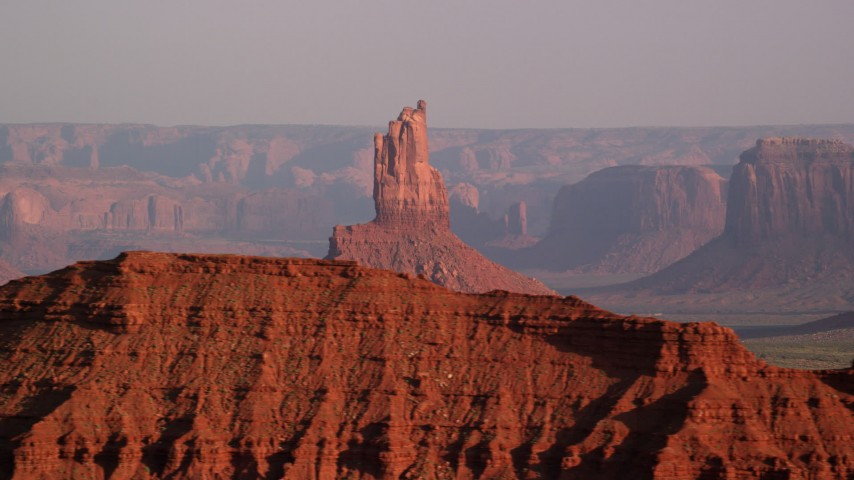 Flying by Big Indian Butte, Monument Valley, Utah, Arizona, sunset Aerial Stock Footage | AX133_009