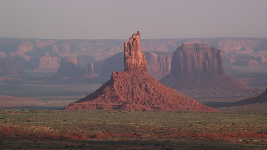 Flying by Big Indian Butte, Monument Valley, Utah, Arizona, sunset Aerial Stock Footage | AX133_010