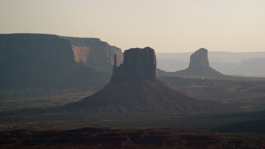 6K stock footage aerial video of flying by West Mitten Butte, Mitchell Butte in Monument Valley, Utah, Arizona, twilight Aerial Stock Footage | AX133_021