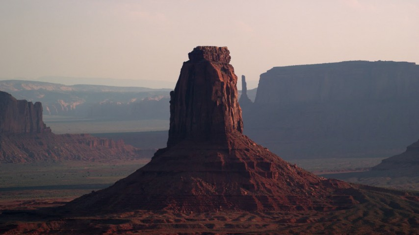 6K stock footage aerial video of flying by East Mitten Butte, Monument Valley, Utah, Arizona, twilight Aerial Stock Footage | AX133_022