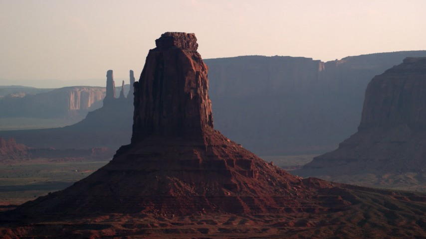 6K stock footage aerial video of passing by East Mitten Butte, Monument Valley, Utah, Arizona, twilight Aerial Stock Footage | AX133_023
