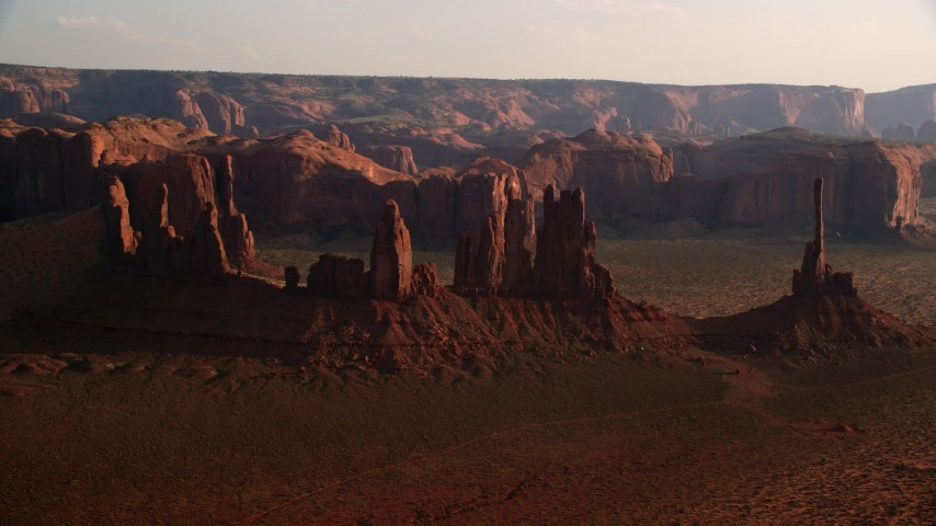 6K stock footage aerial video of approaching buttes in Monument Valley, Utah, Arizona, twilight Aerial Stock Footage | AX133_037
