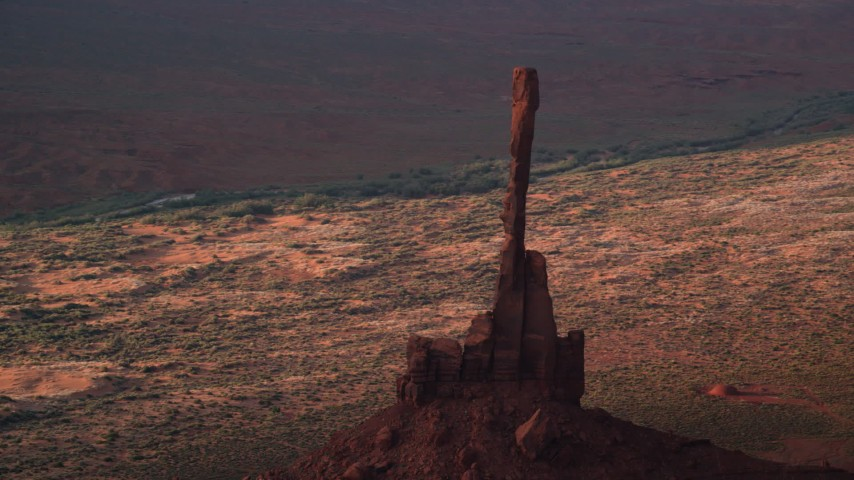 Orbiting Totem Pole Butte, Monument Valley, Utah, Arizona, twilight Aerial Stock Footage AX133_045