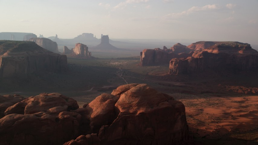 6K stock footage aerial video of flying by and approaching mesas, buttes in Monument Valley, Utah, Arizona, twilight Aerial Stock Footage | AX133_047
