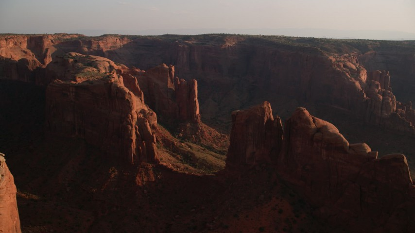 Approaching Hunt's Mesa, Monument Valley, Utah, Arizona, sunset Aerial Stock Footage | AX133_053