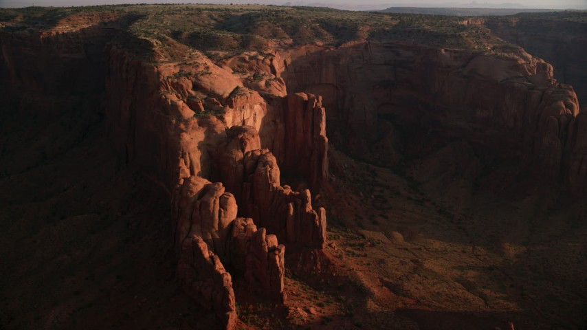 6K stock footage aerial video of passing Hunt's Mesa and rock formations, Monument Valley, Utah, Arizona, sunset Aerial Stock Footage | AX133_056